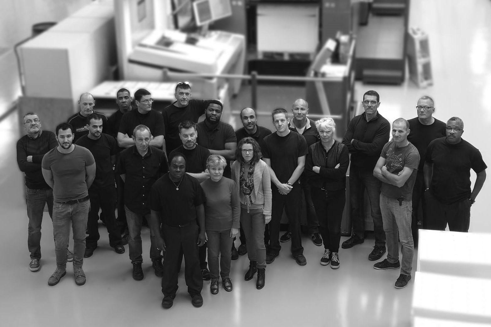 Photo de l'équipe de production de l'imprimerie Martinenq